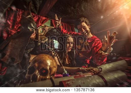 Medieval Inquisitor Is Tempting Witch To Sign The Confession, Butcher Is Holding Her.