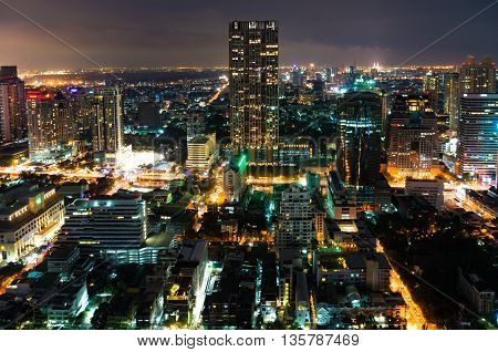 Aerial view of Bangkok city at night. View from above on modern Asian megalopolis cityscape at night