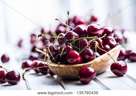 Cherries. Sweet Cherries. Fresh Cherries. Ripe cherries on wooden concrete table - board.