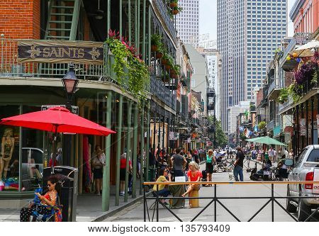 NEW ORLEANS, USA - MAY 14, 2015: Royal Street in French Quarter busy with pedestrians vendors and a band playing live music on the street.