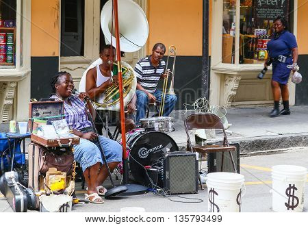 NEW ORLEANS, USA - MAY 14, 2015: Band playing live music on Royal Street in French Quarter.