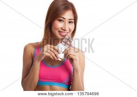 Beautiful Healthy Asian Girl Eat Chocolate