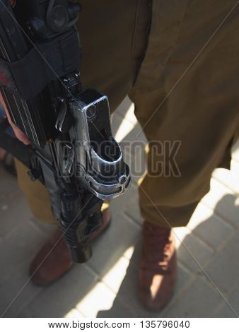 Israeli soldier details with uniform and rifle