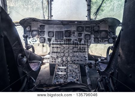 Old abandoned cockpit closeup of the helicopter