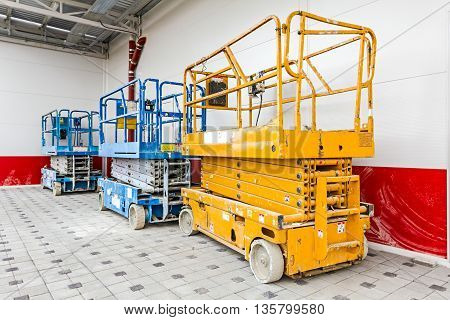 Scissor lift platform parked on a construction site after job is done.