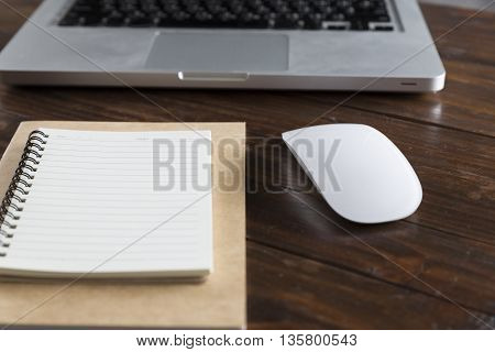 Laptop Computer And Notebook On Office Desk