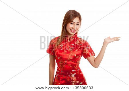 Asian Girl In Chinese Cheongsam Dress Present Blank Space With Her Hand
