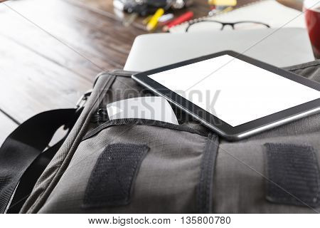 Digital Tablet, Mouse On Bag On Office Desk