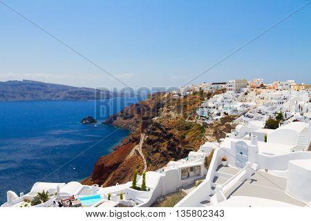 Oia, traditional greek village and Aegan sea waters, Santorini, Greece