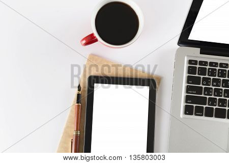 Laptop, Tablet And Notebook On White Background - Top View