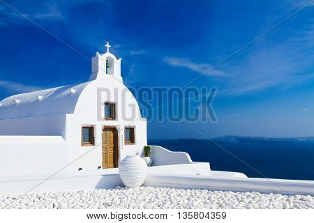 beautiful details of Santorini island - typical house with white walls and blue Aegan sea, Greece