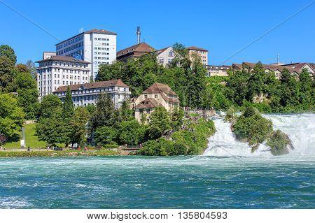 Neuhausen am Rheinfall Switzerland - 22 June 2016: the Rhine Falls. The Rhine Falls (German: Rheinfall) is the largest plain waterfall in Europe located on the Rhine river in Switzerland.