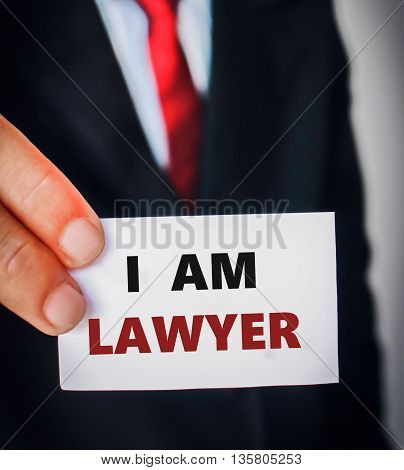 businessman in black suit holding sign lawyer