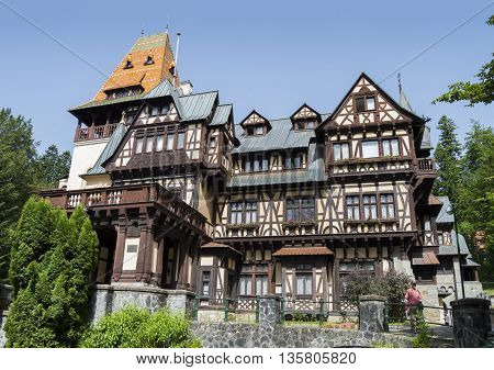 Sinaia, ROMANIA - June 18 2016: Wide view of Pelisor Castle, which is located next to the Peles castle in the Romanian city of Sinaia. SINAIA - June 18 2016