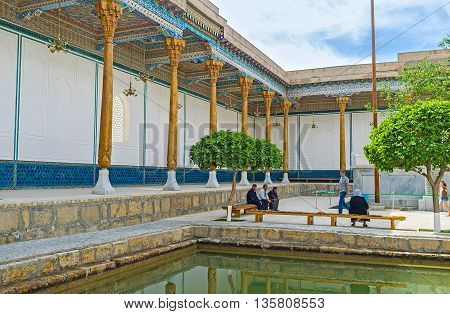 BUKHARA UZBEKISTAN - APRIL 29 2015: The courtyard of the Mausoleum of Hazrat Muhammad Bahauddin Shah Naqshband decorated with the scenic terrace and the tiny garden on April 29 in Bukhara.