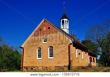 Bethabara North Carolina - April 23 2016: 1788 Gemeinhaus Moravian Church with attached minister's house at Bethabara historic settlement *