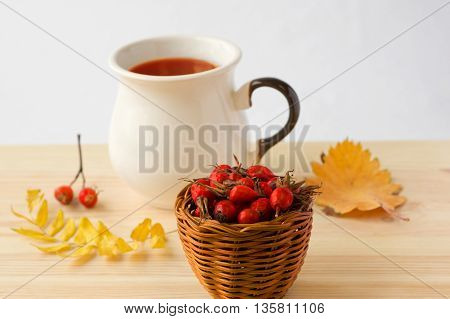 rose hip tea on a wooden background