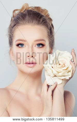 Spa Woman with Blonde Hair and White Rose Flower. Skin Care Concept