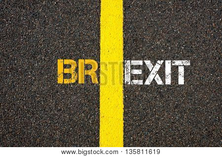 Concept of BREXIT UK United Kingdom versus EU EUROPEAN UNION written over tarmac road marking yellow paint separating line between words