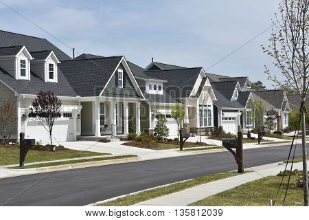 Chapel Hill North Carolina - April 19 2016: Newly built contemporary homes line a street at the Briar Chapel residential Village