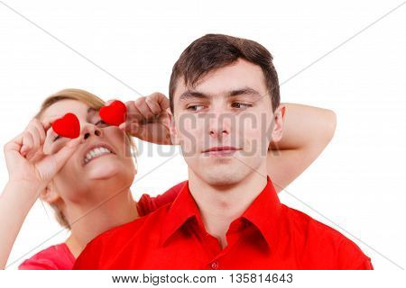 Serious Man And Crazy Woman Holds Red Hearts Over Eyes