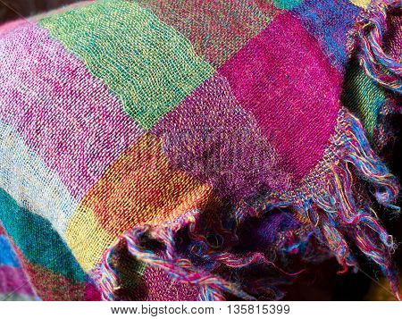 Colorful ethnic hand woven fabric material cloth on display in a market