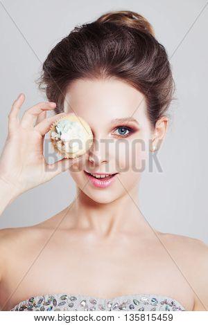Happy Girl holding Sweet Cake on light background
