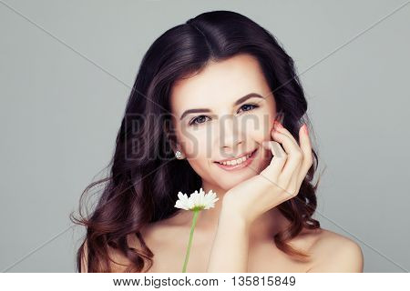 Smiling Woman with Healthy Hair. Wavy Hairstyle and Clear Skin
