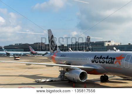 TOKYO, JAPAN - circa JUNE 2016: Jetstar Aircraft towed at Narita International Airport, Japan. Jetstar Airways Pty Ltd, trading as Jetstar, is an Australian low-cost airline headquartered in Melbourne, Australia. Jet Star Japan is their sister airline.