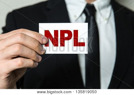 Business man holding a card with the text: NPL