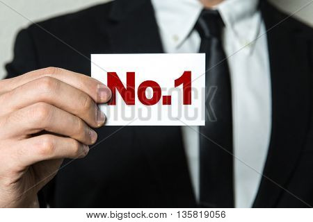 Business man holding a card with the text: No.1