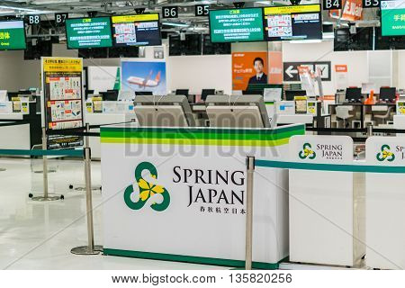NARITA, JAPAN - circa JUNE 2016: Spring Airline Japan ticket counter at Narita airport, Tokyo, Japan.  Spring Japan is a low-cost airline headquartered in Kozunomori, Narita, Japan. It is 33% owned by Spring Airlines, a Chinese low-cost carrier, with the