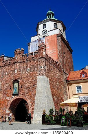 Lublin Poland - June 5 2010: 14th century Krakow Gate and 16th century tower topped by an 18th century roof now houses the Lublin Historical Museum