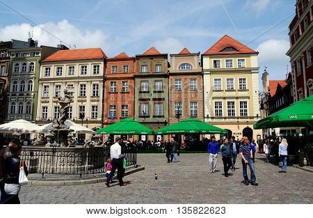 Poznan Poland - May 23 2010: Row of colourful baroque 17th century houses lines Rynek market square