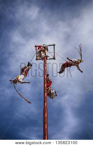 IXTAPA MEXICO - DECEMBER 24 2015: The Danza de los Voladores (Dance of the Flyers) or Palo Volador (pole flying) is an ancient Mesoamerican ceremony/ritual still performed today in Mexico. It is believed to have originated with the Nahua Huastec and Otomi