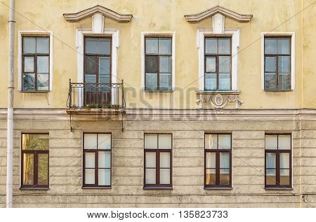 Several windows in a row and balcony on facade of urban apartment building front view St. Petersburg Russia poster