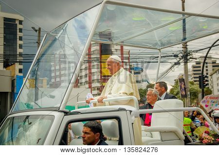 QUITO, ECUADOR - JULY 7, 2015: Nice moment in the photograph, pope Francisco very near with people.