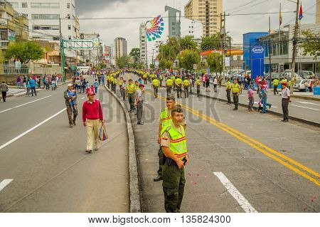 QUITO, ECUADOR - JULY 7, 2015: Lots of people expecting to see pope Francisco in Quito, police on the street.