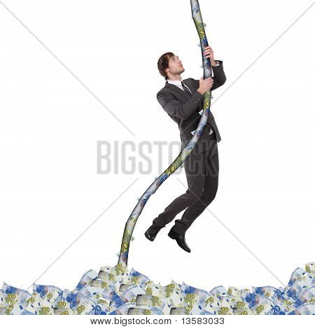 business man climbing up the money rope