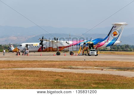 Mae Sot Thailand DEC 20, 2014: Unidentified group of people walked to BOMBARDIER Q400 NextGen