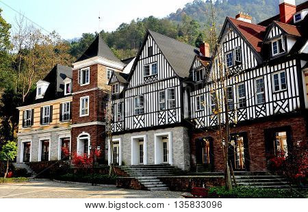 Bai Lu China - November 17 2013: French style half-timbered manor houses line a square in the Sino-French village