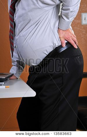 Buisness man experiencing back pain