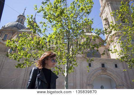 Woman Walking In Front Of El Pilar In Zaragoza