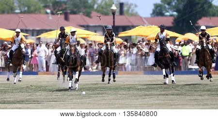JERSEY CITY, NJ-MAY 30: Nacho Figueras (C) and other polo players chase the ball during a polo match at the Annual Veuve Clicquot Polo Classic at Liberty State Park on May 30, 2015 in Jersey City, NJ.