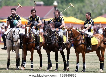 JERSEY CITY, NJ-MAY 30: (L-R) Rico Mansur, Nacho Figueras, Javier Tanoira and Bill Ballhaus at the 8th Annual Veuve Clicquot Polo Classic at Liberty State Park on May 30, 2015 in Jersey City, NJ.