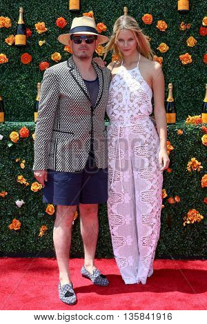 JERSEY CITY, NJ - MAY 30: Model Nadine Leopold and designer Eli Mizrahi attend the 8th Annual Veuve Clicquot Polo Classic at Liberty State Park on May 30, 2015 in Jersey  City, New Jersey.