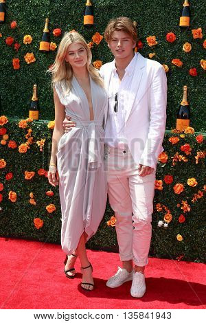 JERSEY CITY, NJ - MAY 30: Models Jordan Barrett (L) and Megan Irwin attend the 8th Annual Veuve Clicquot Polo Classic at Liberty State Park on May 30, 2015 in Jersey  City, New Jersey.