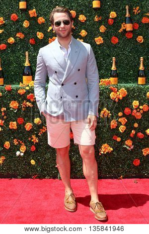 JERSEY CITY, NJ - MAY 30: Derek Blasberg attends the 8th Annual Veuve Clicquot Polo Classic at Liberty State Park on May 30, 2015 in Jersey  City, New Jersey.