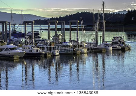 Juneau, Alaska USA - July 21, 2012.  Boats Docked At Sunset Outside Juneau, Alaska