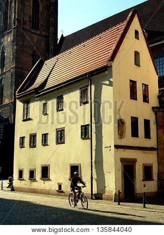 Wroclaw Poland - June 14 2010: A cyclist passes by one of the two